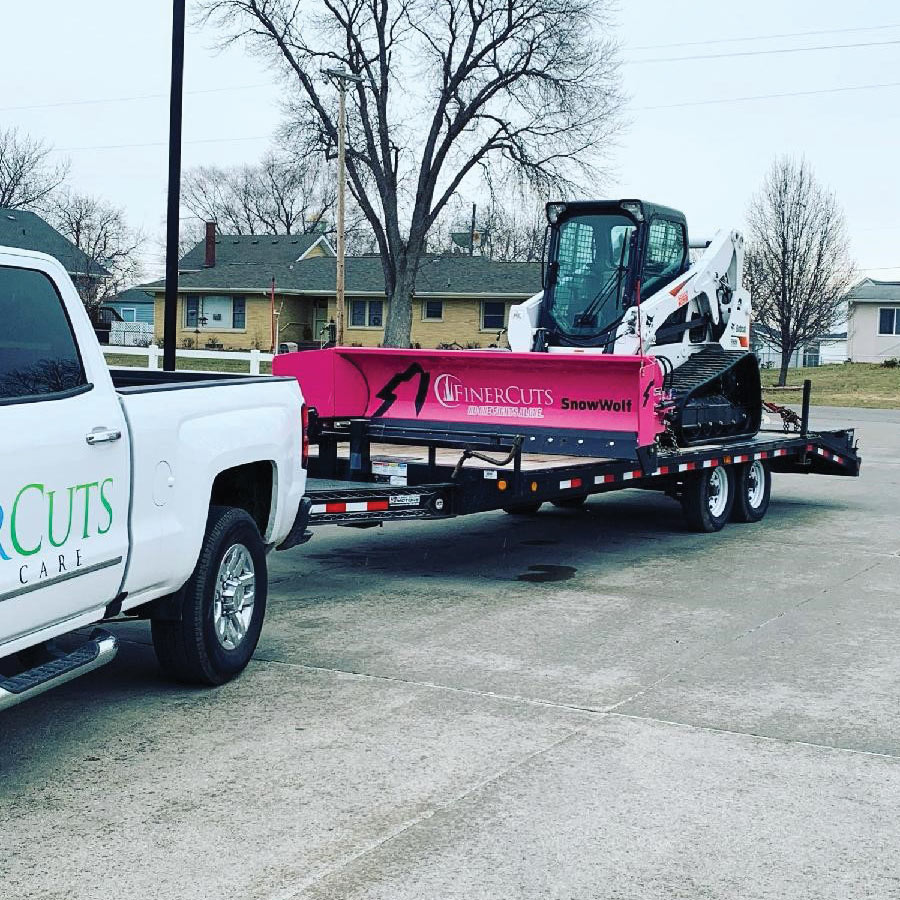 Finer Cuts Snow Removal with SnowWolf QuattroPlow Breast Cancer Awareness Edition