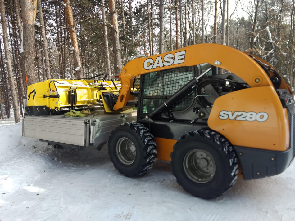 New Holland L190 with QuattroPlow and WolfPaws skid steer snow tires